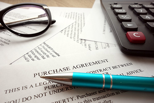 Business Purchase agreement, pen and glasses